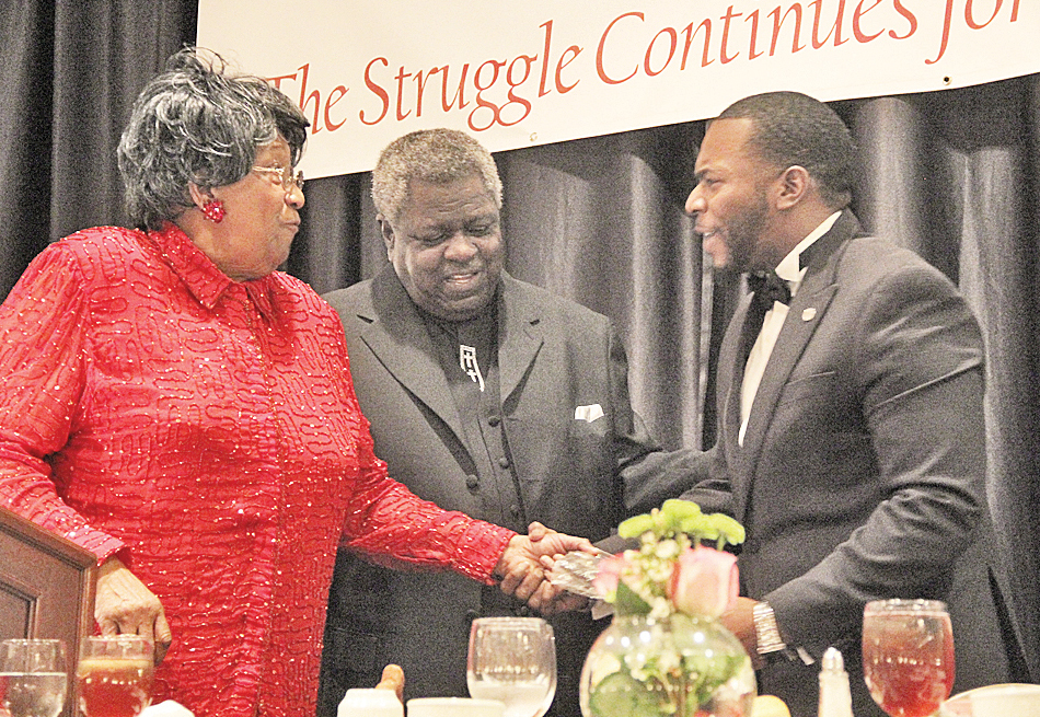 SCLC President Pernella Chubb Wilson and Vice President Bishop Edward Mitchell congratulate Jeff May, one of several recipients of the Drum Major for Justice Award.   photos by S. Hale