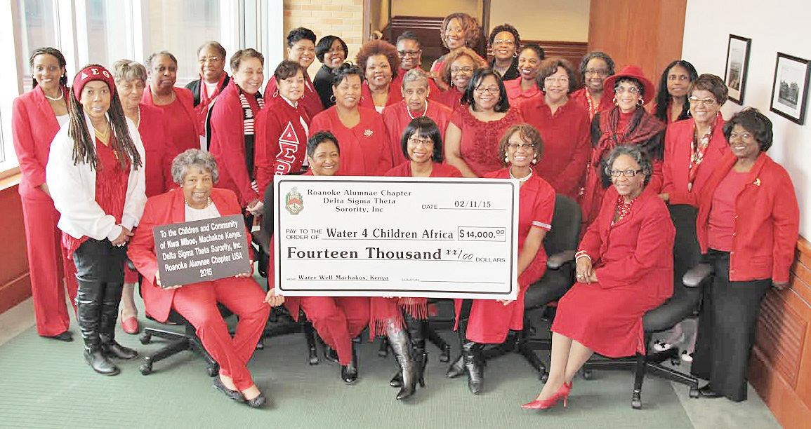 Donation: Roanoke Deltas proudly pose with check representing their donation to the Water 4 Children Africa project.