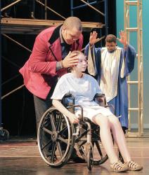Christian Bryant as Jonas prays for Jane McGowan, (Olivia Hunter) in wheelchair. Brother Carl (Thaddeus Donner) prays in background.