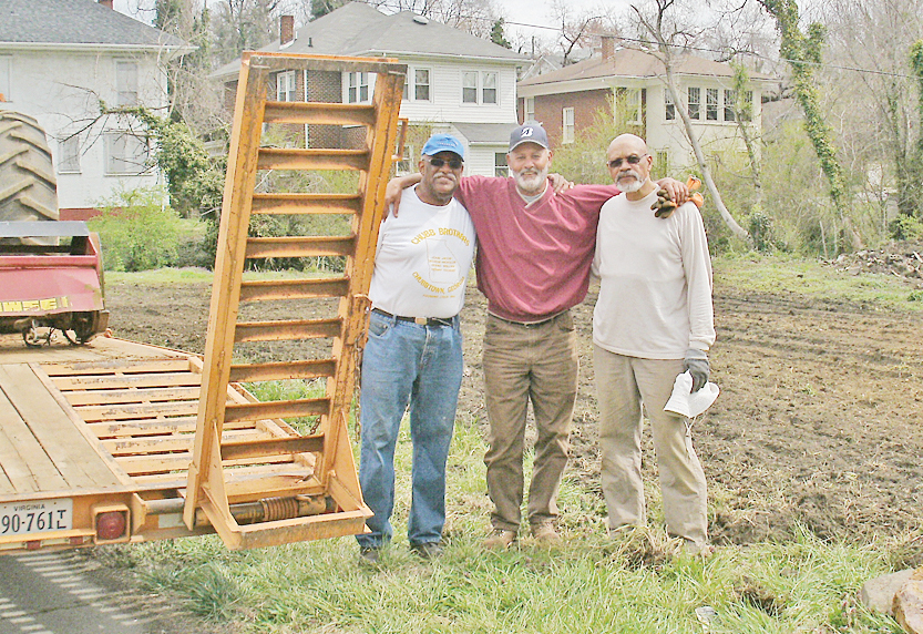 (from left) Bro. Richard Chubb; Benny Hopkins, Rev. Carroll Carter, pastor of St.Paul United Church who are among those preparing the land, along with Andre' Peery (not pictured).