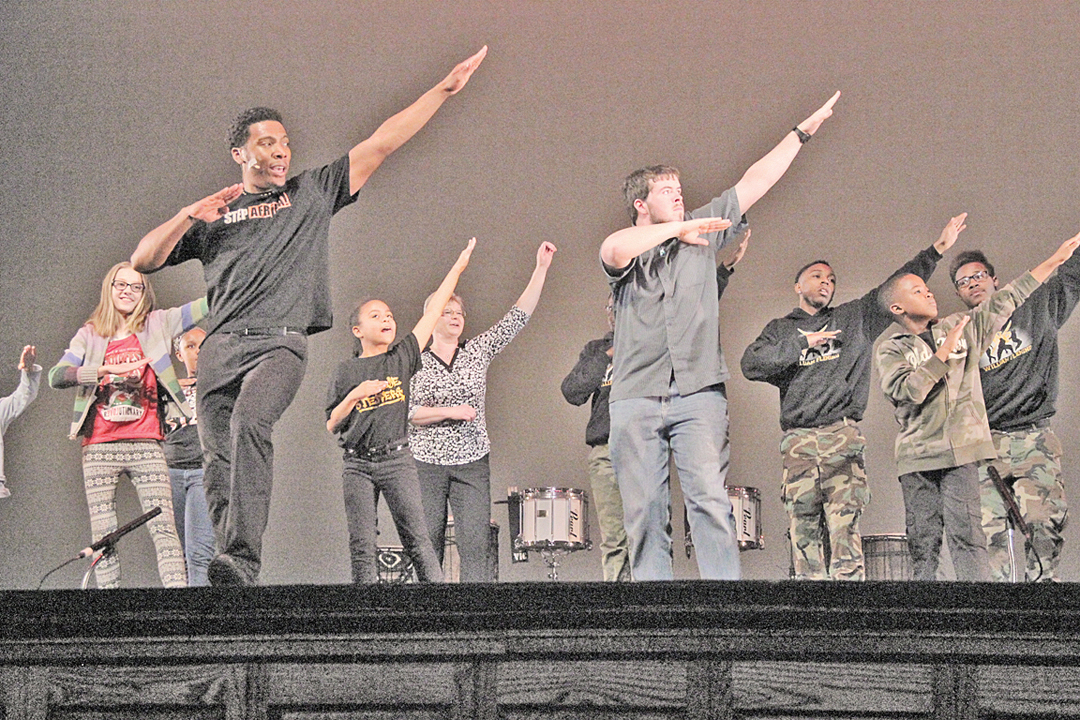 Step Afrika's Artis Olds instructs audience members in stepping.