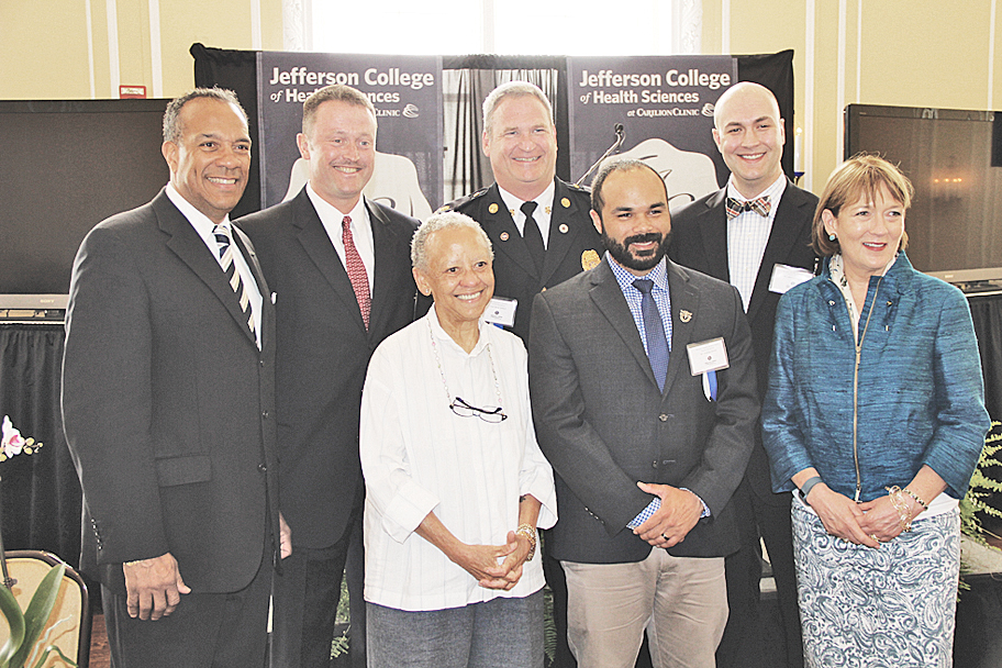 JCHS Luncheon (from left): Nathaniel Bishop, president, JCHS; E.W. Tibbs, president, chief executive officer, Centra Health, Inc.; Professor Nikki Giovanni; Chief David Hoback, Roanoke Fire-EMS Dept.; Cornelius Powell, Dr. Albert G. Pavalonis and Nancy Howell Agee, president, CEO of Carilion Clinic.