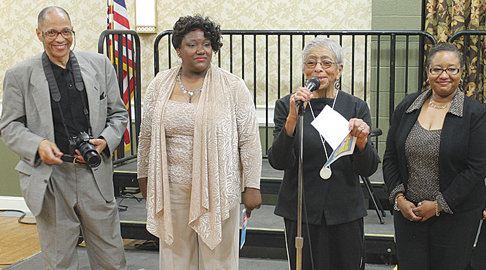 Celebration (from left): Tribune Asso. Editor Stan Hale; Germaine Fletcher, program MC; Editor Claudia Whitworth and Co-MC Pam Banks at the Showcase held at the Salem Civic Center.