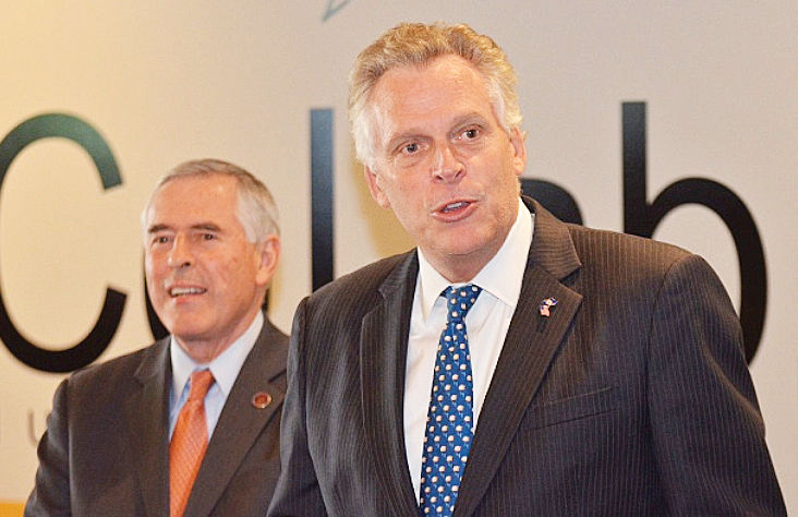 Virginia Governor Terry McAuliffe (right) and Senator John Edwards join in efforts ordering the Confederate flag to be removed from Virginia state license plates.
