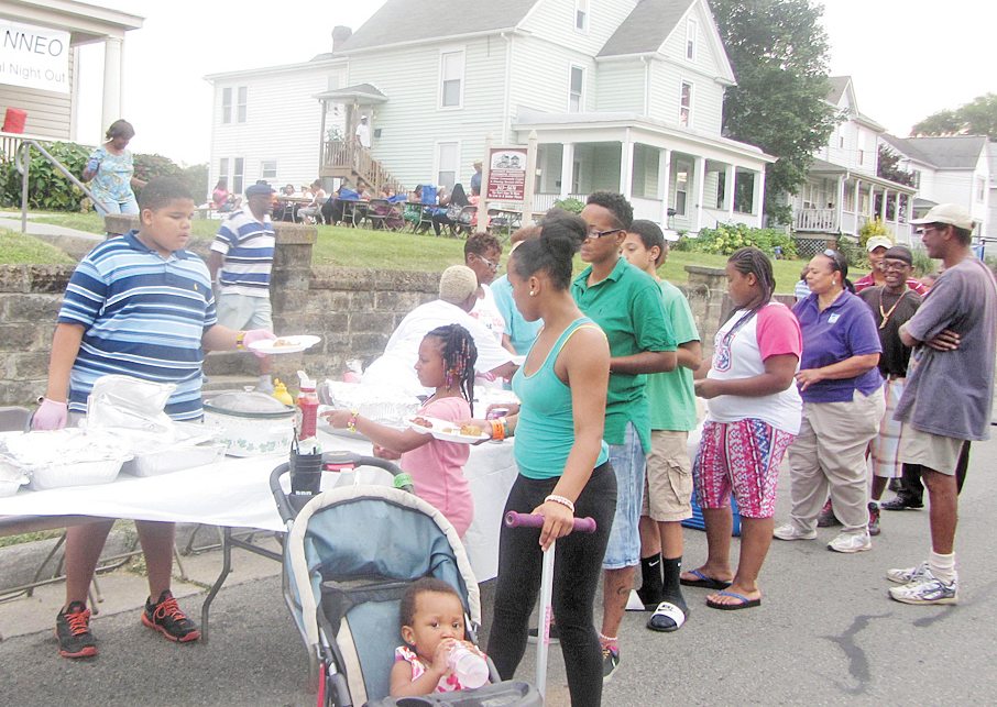 Residents file through the line at the NNEO National Night Out celebration. (Photos by Kamila Love)