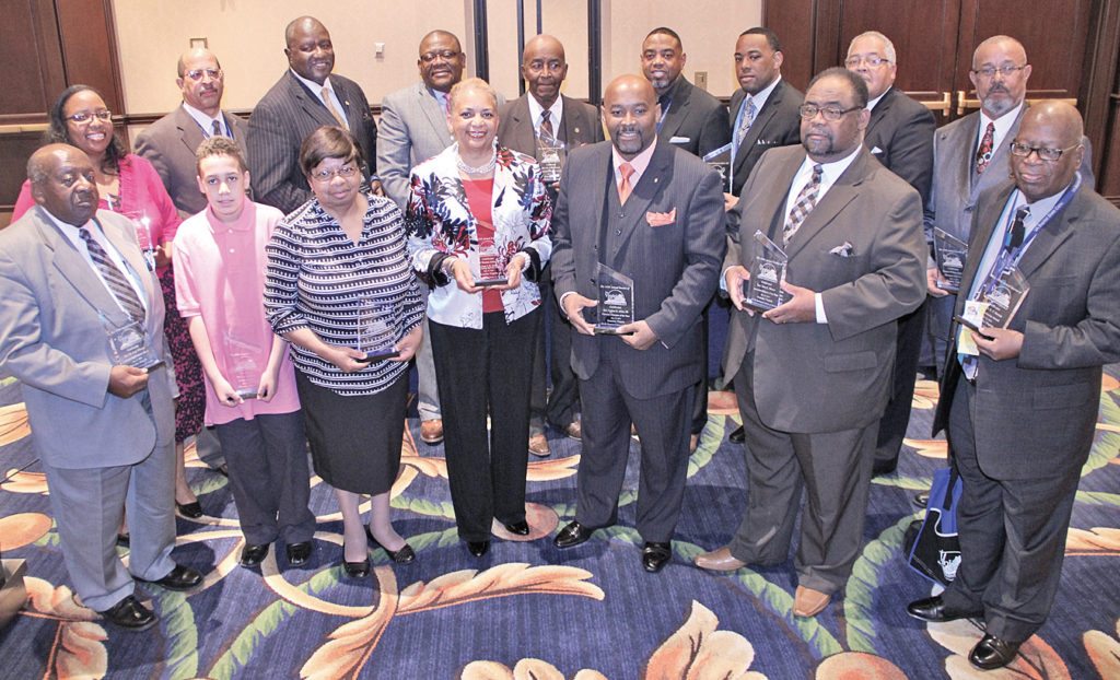 Honorees (from left, front row): Rev. Dr. Jack Wilson, Aaron Glenn, Cynthia Forrest, Vice Mayor Anita Price, Rev. Luther Allen, III, Rev. Terry Moore and Rev. Dr. E.T. Burton. Back row: Quentina Enoch, Tim Otey, Mayor Sherman Lea, Donald Barrow, Rev. Dr. Paul Johnson, Rev. Dr. Melvin Blackwell, Rev. Corey Taylor, Rev. Charles Calloway and Deacon William Graves. All pose Thursday, May 12 at the Virginia Baptist State Convention held at Hotel Roanoke.
